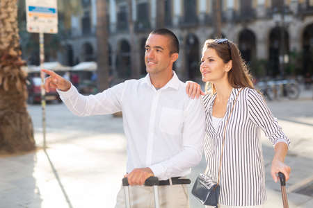 Couple of tourists admiring city views while traveling