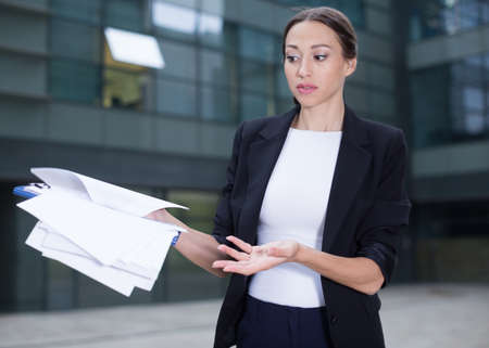 Serious businesswoman is dissatisfied of the results of the financial report