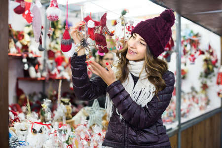 Portrait of female customer near counter with Christmas gifts Foto de archivo