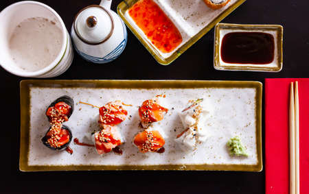 Delicious various sushi set served on plate in restaurant
