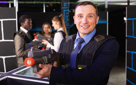 Businessman playing laser tag