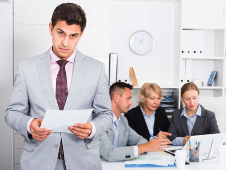 Angry manager dissatisfied with colleagues Imagens