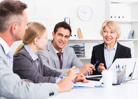 Business people developing strategy in office