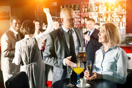 Man and woman drinking alcohol on party