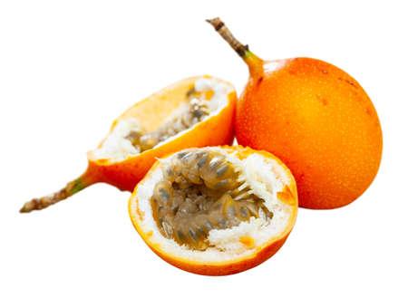 Orange passiflora fruit whole and halves