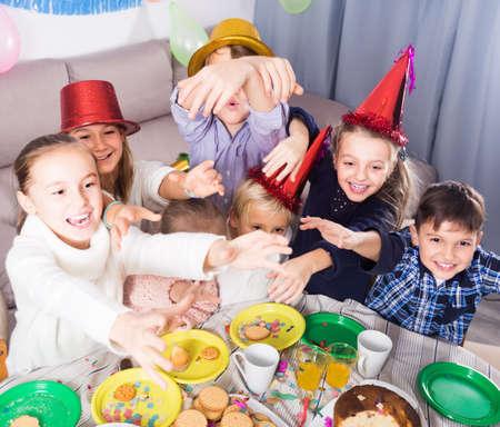 vigorous kids having a good time at a birthday party Stok Fotoğraf