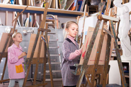 Schoolgirl practicing their skills during painting class