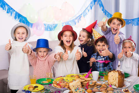 children having celebration of friend birthday during dinner Stok Fotoğraf