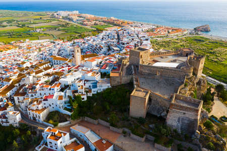 View from drone of castle in Salobrena with Mediterranean Sea on horizon