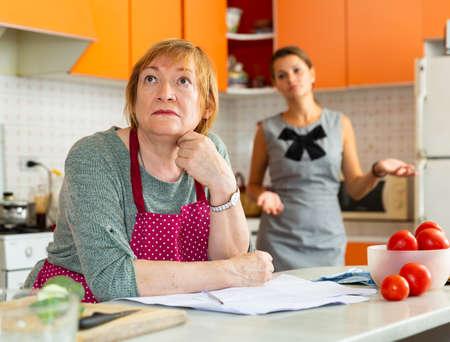 Upset elderly mother with dissatisfied adult daughter