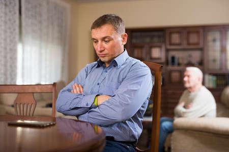 Senior man and his son quarreling