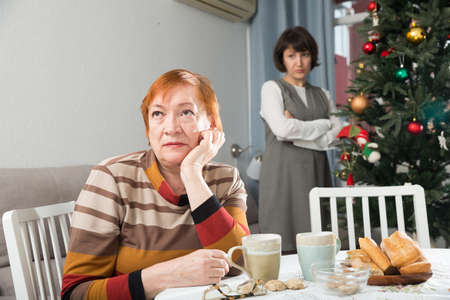 Senior woman offended after quarrel with daughter Stock Photo