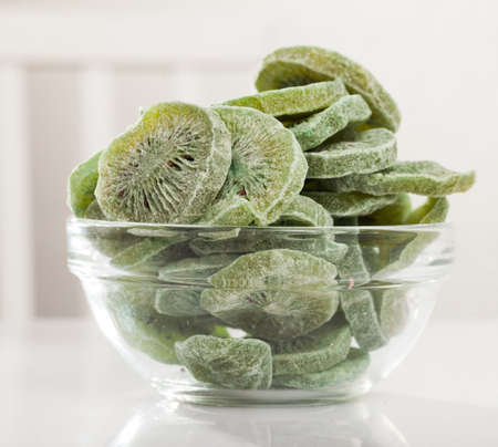 Dehydrated kiwi slices in bowl Stock Photo