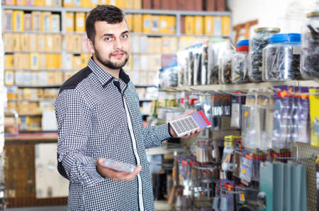 man deciding on best DIY details in houseware store