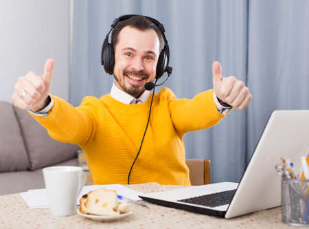 Man studying remotely at home Stock Photo