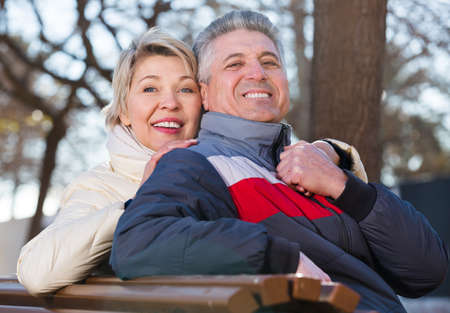 Smiling mature couple relaxing in park