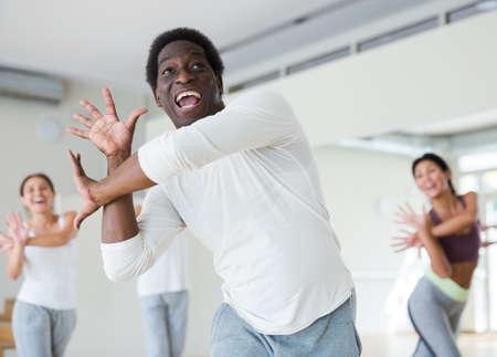 Young adult man exercising at dance class Standard-Bild