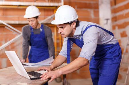 Builders using laptop