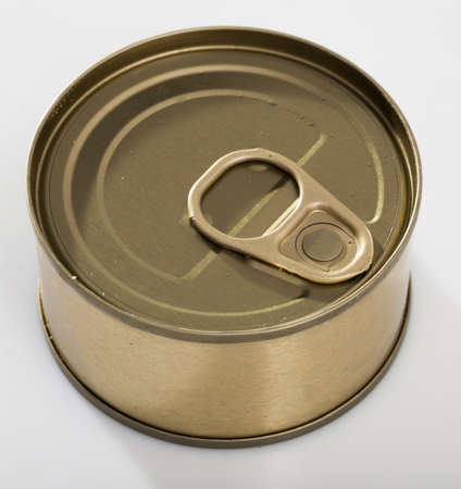 Close-up of metal bronze tin can with ring pull on white background
