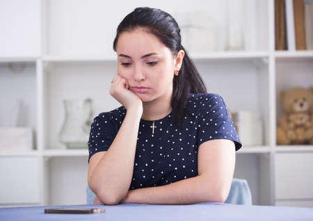 Girl waiting for phone call Stockfoto