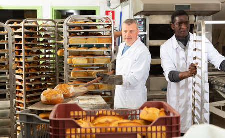 Bakers arranging bakery products