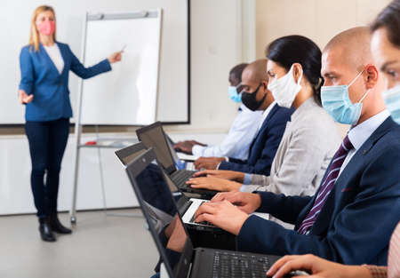 international group of managers with laptop in advanced training courses during epidemic