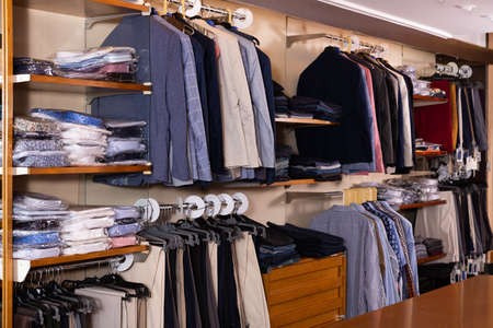 Men clothing store with variety of suit coats