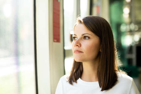 Woman traveling in public transport Stock Photo