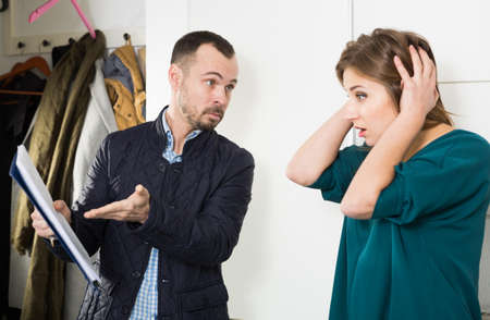 Annoyed debt collector and shocked woman