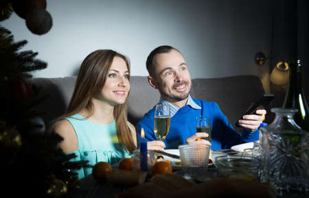 Couple celebrating New Year and watching tv