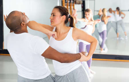Hispanic girl practicing elbow strike during self defence course