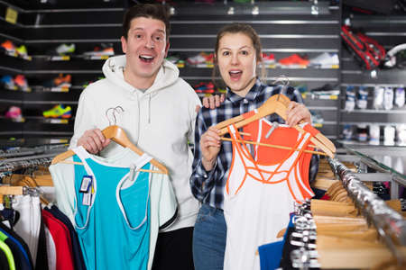 Woman and man are choosing tennis uniform 版權商用圖片