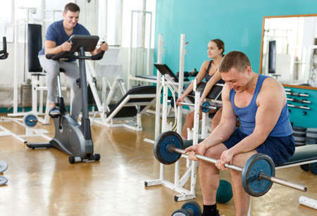 Man doing exercises with barbell Stok Fotoğraf