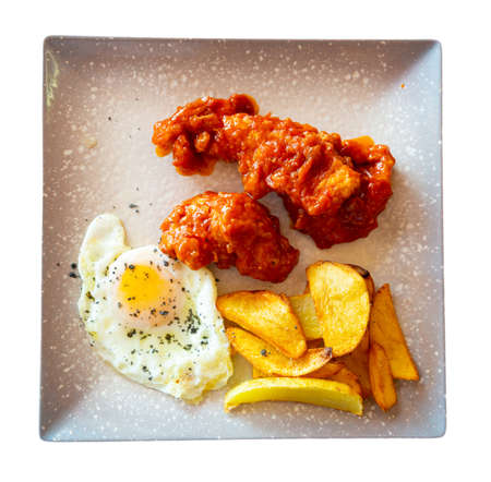 Spicy chicken with baked potato and fried egg