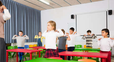 Pupils doing warm-up with teacher