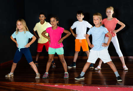 Children studying modern style dance in class