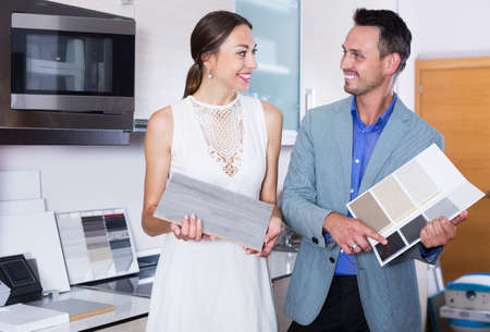Couple choosing kitchen fronts materials