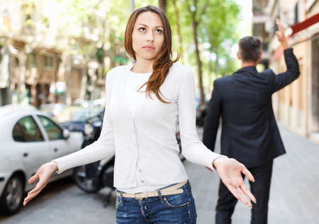 Young brunette in quarrel with boyfriend