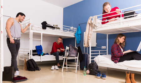 Young people interacting in hostel Stock Photo
