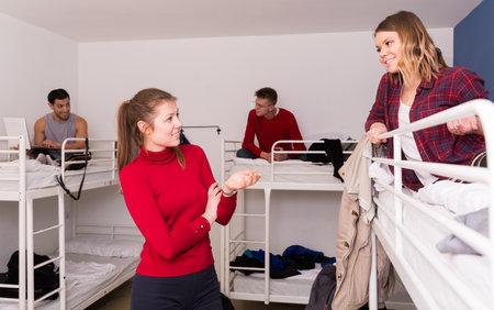 Female travelers discussing in hostel