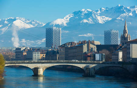 Aerial view of Grenoble cable car with French Alps and bridge