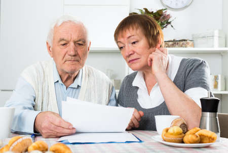 Aged couple struggling to pay bills
