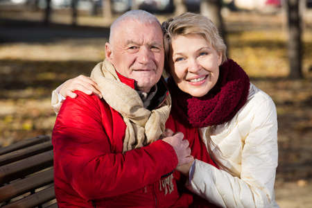 Mature couple sitting in park