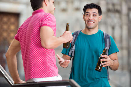 Men friends are talking and drinking beer