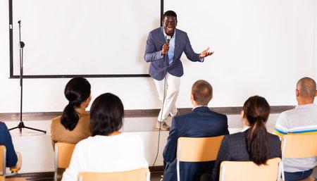 Emotional aframerican business coach giving motivational training