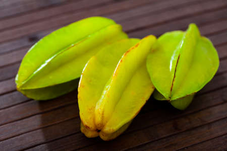 Carambola fruit on wooden table closeup