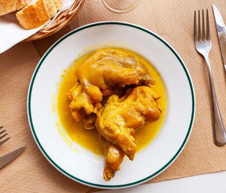 Braised pettitoes, spicy pig feet cooked with sauce
