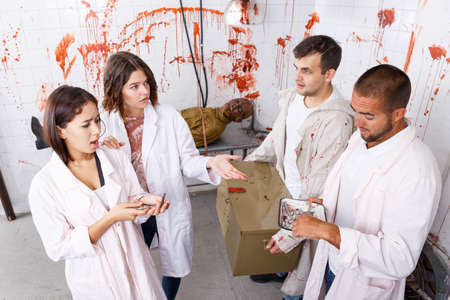 Young adults in escape room with traces of blood