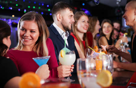 Woman with friends at nightclub