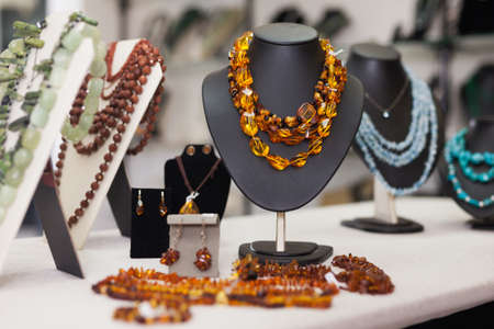 Counter with amber jewelry in store